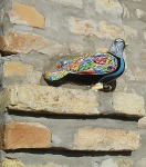 Ukras – skulptura goluba iz ateljea akademskog umjetnika, spomen na dane kad se Mladen Siber bavio sportskim golubarstvom